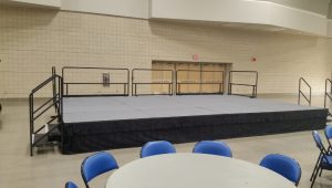 portable stage with guardrails